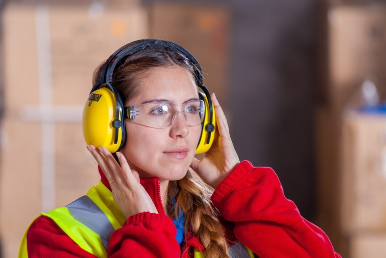 Women with Ear Protection and Safety Vest and Safety Glasses