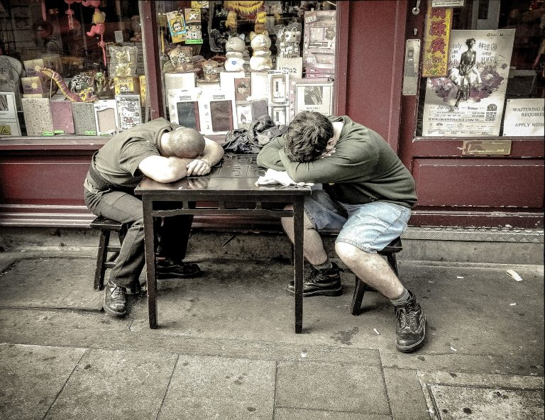 Two Workers Sleeping at a Table