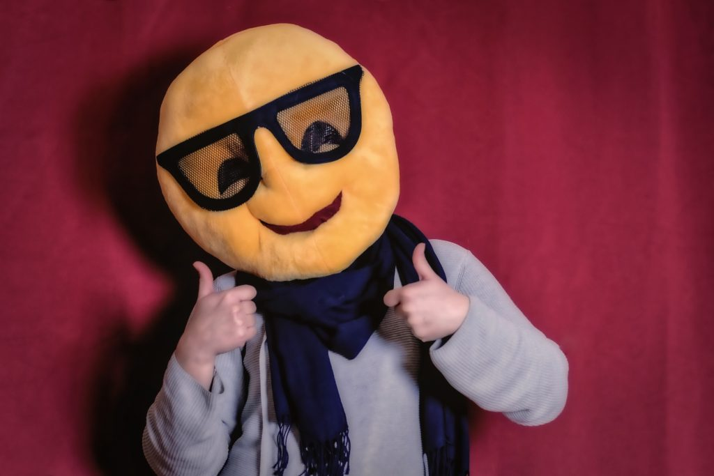 Man with Smiley Face Costume and Thumbs Up